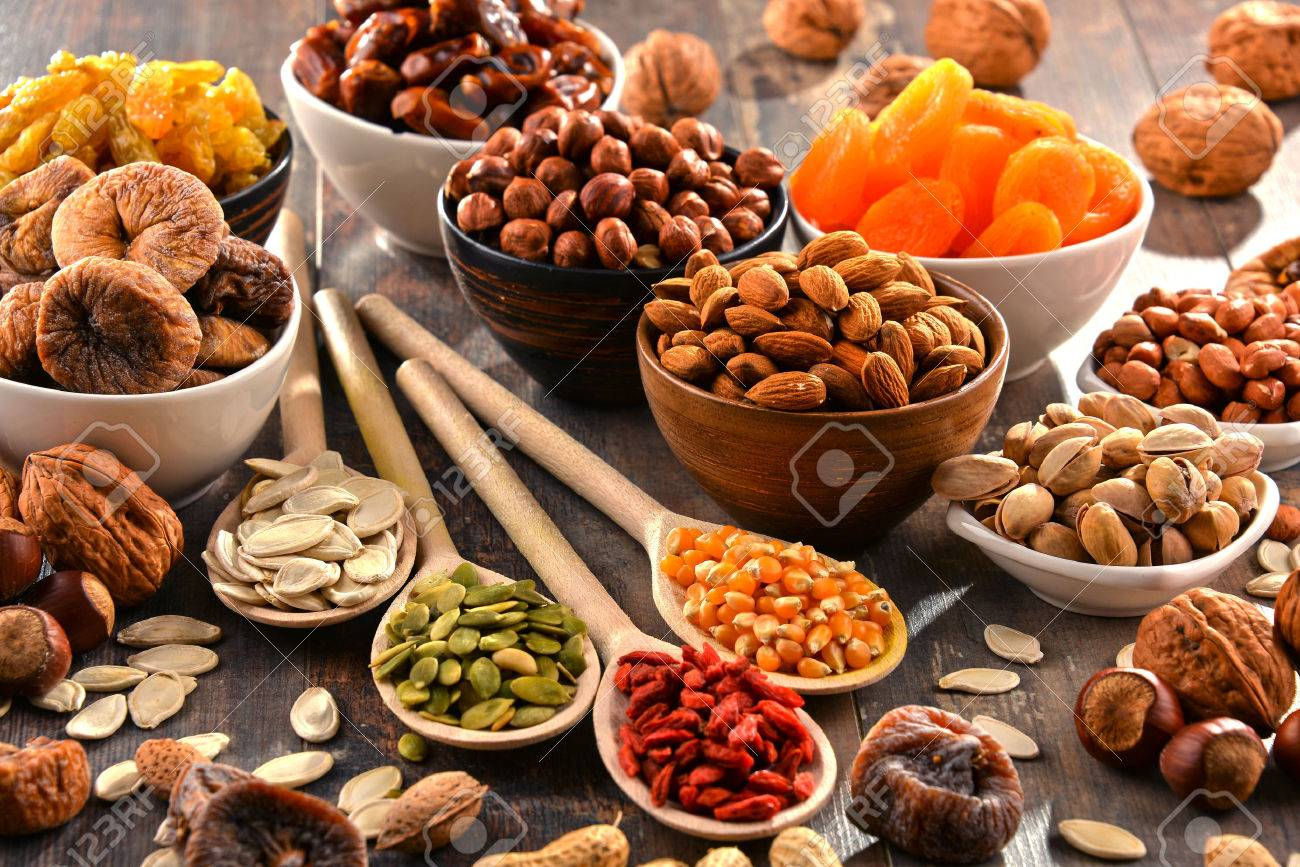 Composition with dried fruits and assorted nuts. - 54344530