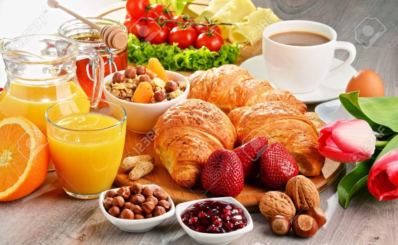 Breakfast consisting of croissants, coffee, fruits, orange juice, coffee and jam. Balanced diet. - 54722151