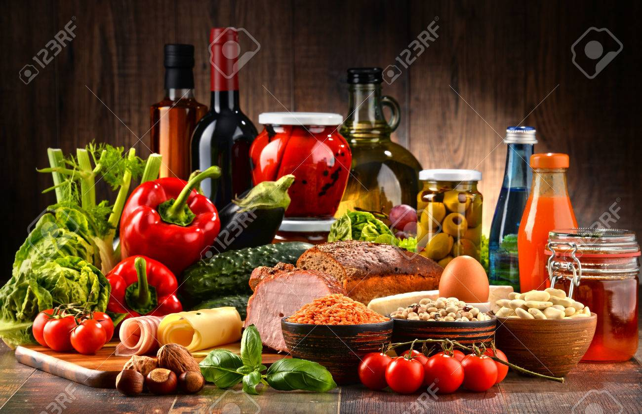 Composition with variety of organic food products on kitchen table - 61847354