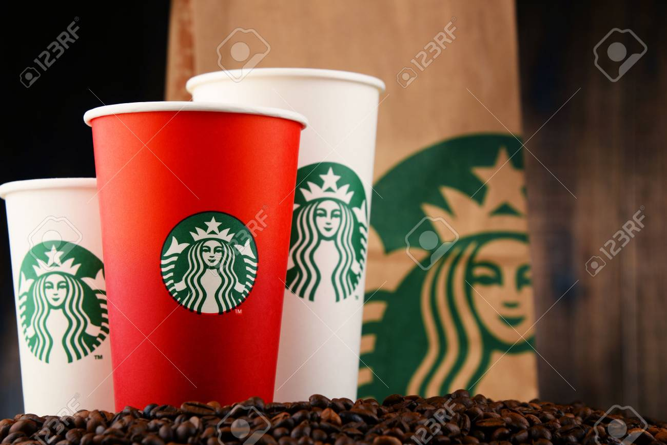 POZNAN, POLAND - DEC 15, 2016: Starbucks, coffee company and coffeehouse chain, founded in Seattle, Wa. USA, in 1971; now the largest business of this kind in the world operates 23,450 locations - 69047476