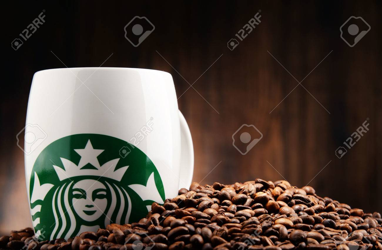 POZNAN, POLAND - DEC 15, 2016: Starbucks, coffee company and coffeehouse chain, founded in Seattle, Wa. USA, in 1971; now the largest business of this kind in the world operates 23,450 locations - 69047494