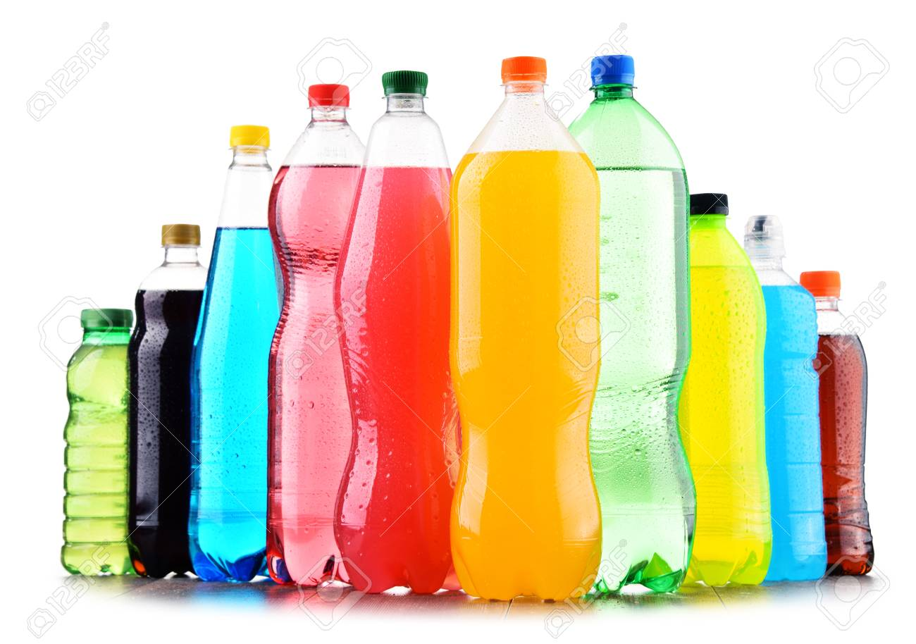 Plastic bottles of assorted carbonated soft drinks over white background - 97376730