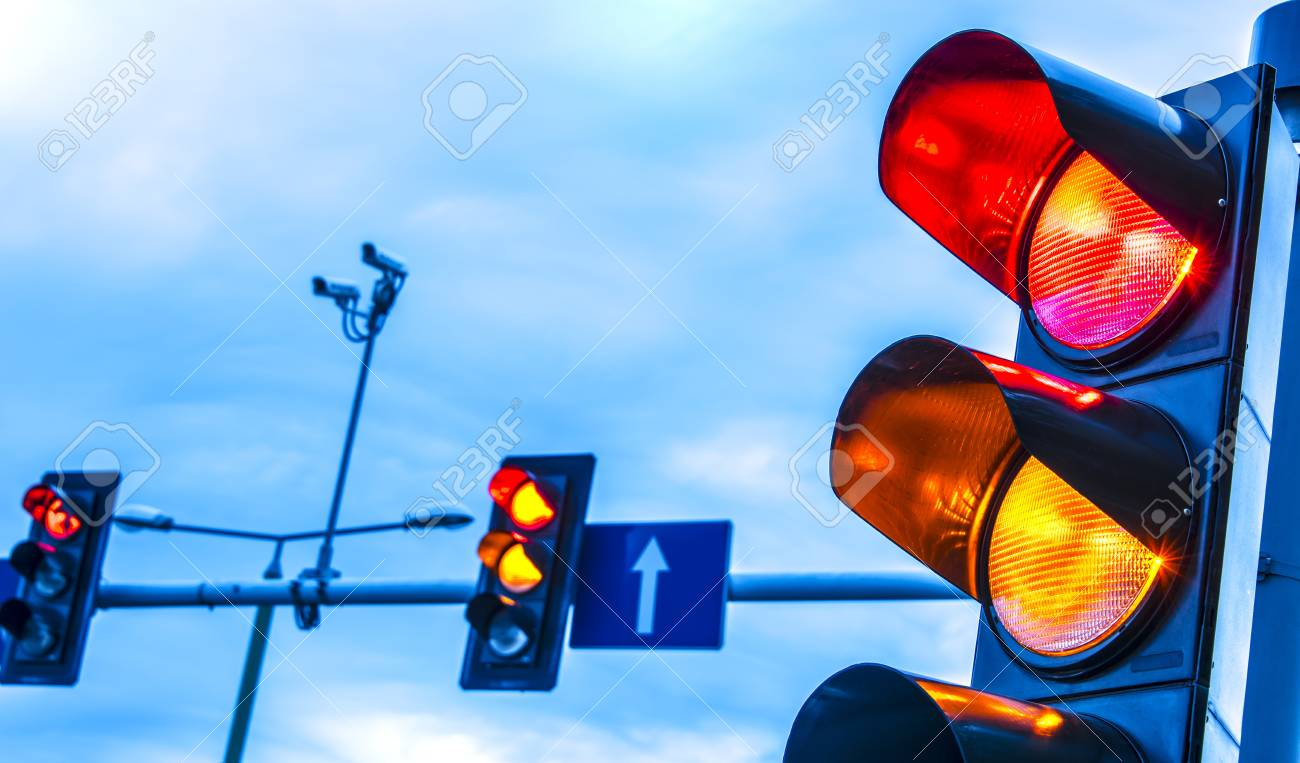 Traffic lights over urban intersection. - 107505250