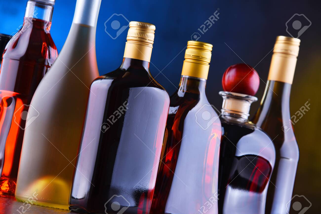 Composition with bottles of assorted alcoholic beverages. - 120322582