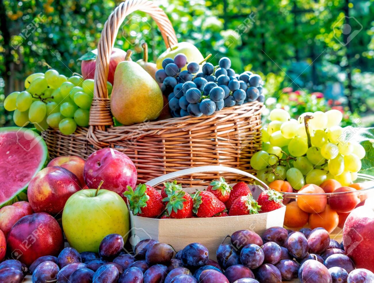 Variety of fresh ripe fruits in the garden. Balanced diet - 129951983