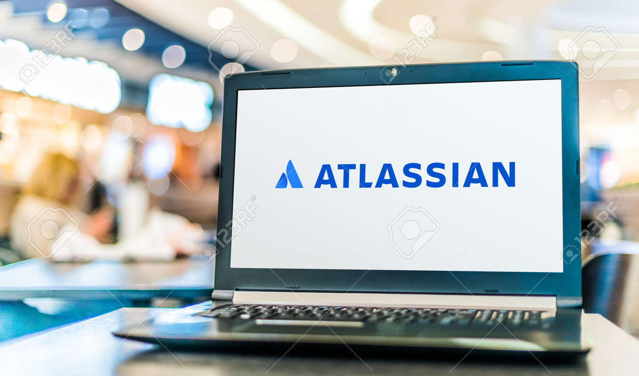 POZNAN, POL - SEP 23, 2020: Laptop computer displaying logo of Atlassian Corporation, an Australian software company that develops products for software developers and project managers - 167657761
