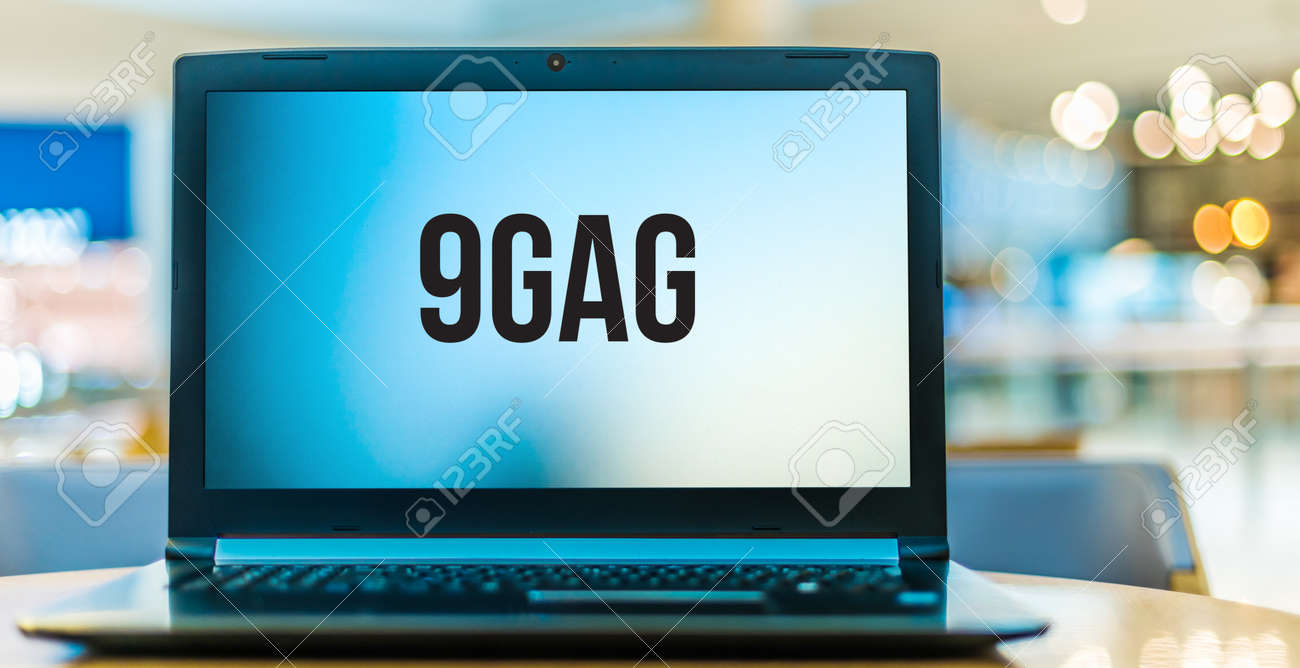 """POZNAN, POL - JAN 6, 2021: Laptop computer displaying logo of 9GAG, an online platform and social media website, which allows its users to upload and share """"user-generated content"""" - 167657755"""