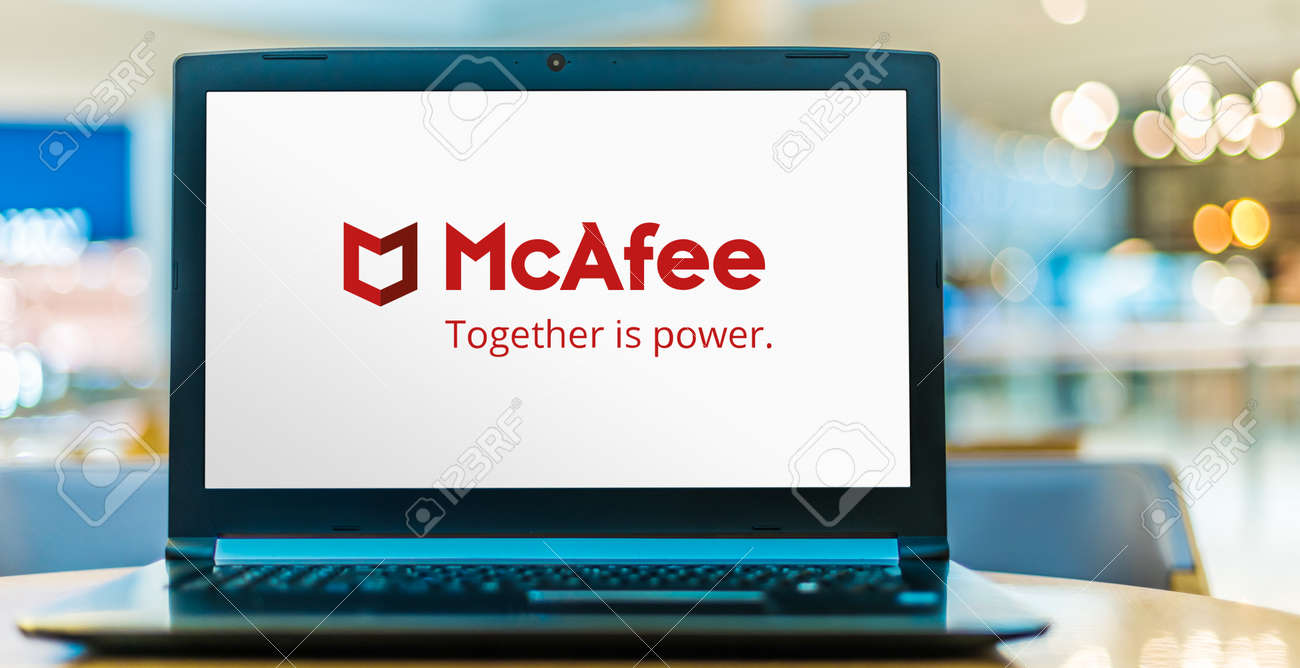 POZNAN, POL - SEP 23, 2020: Laptop computer displaying logo of McAfee, a global computer security software company headquartered in Santa Clara, California, USA - 167657749