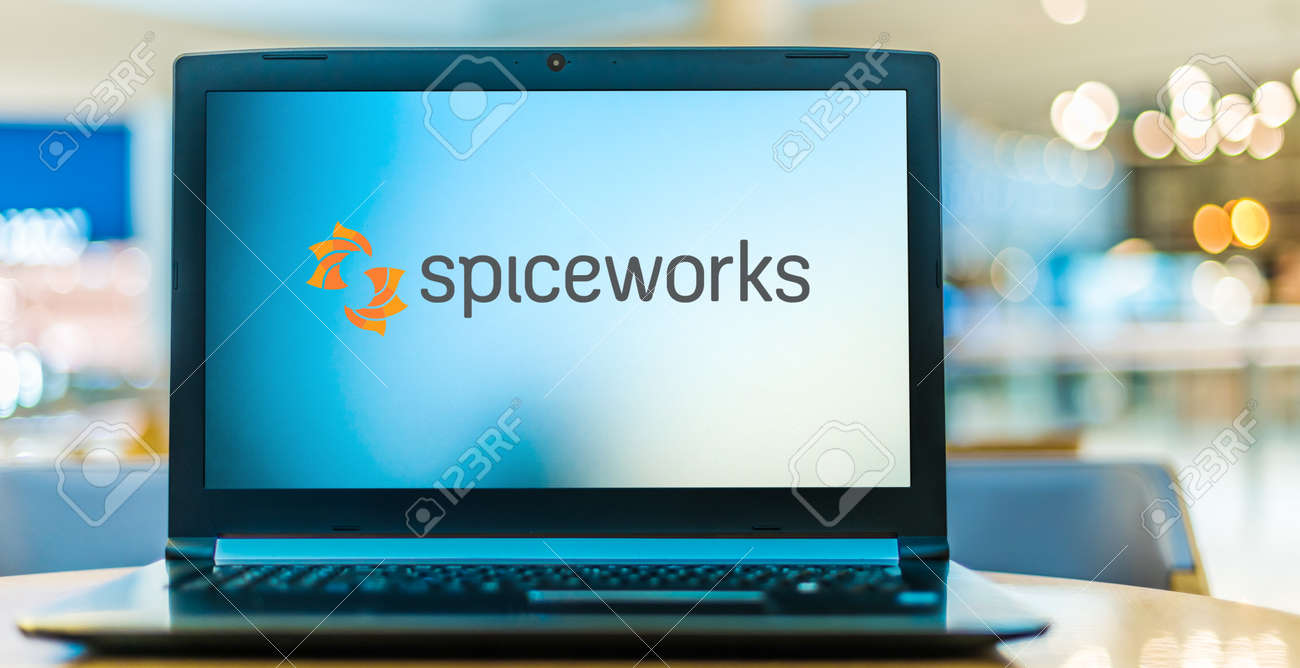 POZNAN, POL - NOV 12, 2020: Laptop computer displaying logo of Spiceworks, a professional network for the information technology (IT) industry that is headquartered in Austin, Texas - 167657768