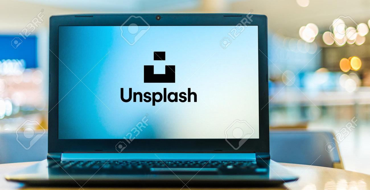 POZNAN, POL - JAN 6, 2021: Laptop computer displaying logo of Unsplash, a website dedicated to sharing stock photography under the Unsplash license. - 167657777