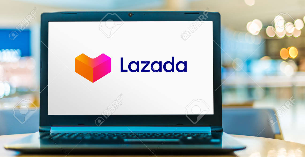POZNAN, POL - SEP 23, 2020: Laptop computer displaying logo of Lazada, an international e-commerce company founded in 2012 and owned by Alibaba Group. - 167657773