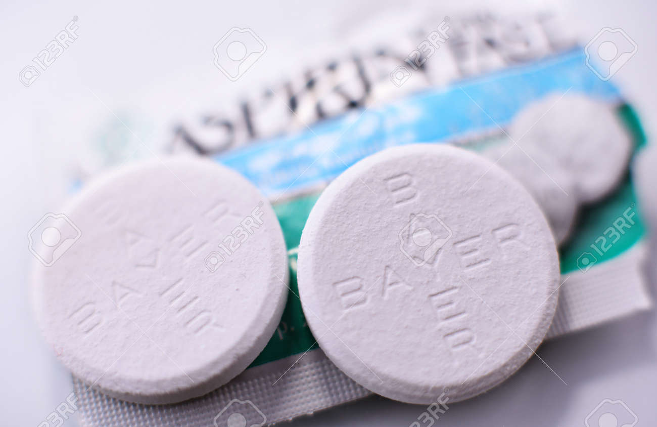 POZNAN, POL - FEB 17, 2021: Aspirin pills, a brand of popular medication, the first and best-known product of Bayer, German multinational pharmaceutical company headquartered in Leverkusen - 167709713