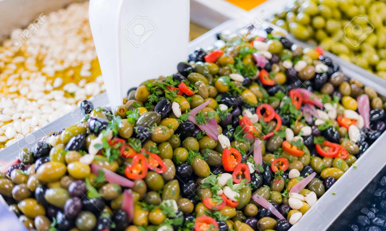Fresh olives put up for sale in a supermarket. - 169105195
