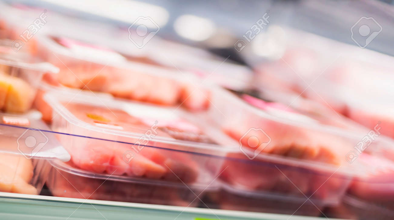 Meat products put up for sale in a supermarket commercial refrigerator - 169105197