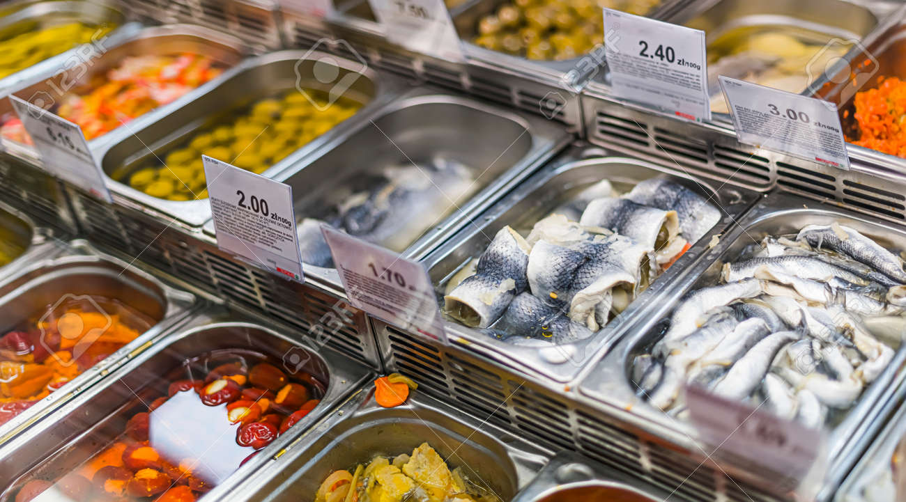 Marinated food products put up for sale in a supermarket commercial refrigerator - 168773795
