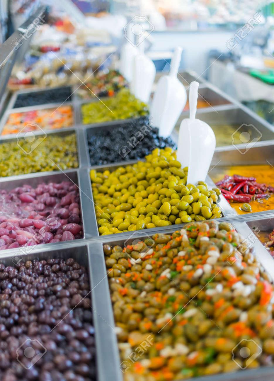 Fresh olives put up for sale in a supermarket. - 168773797