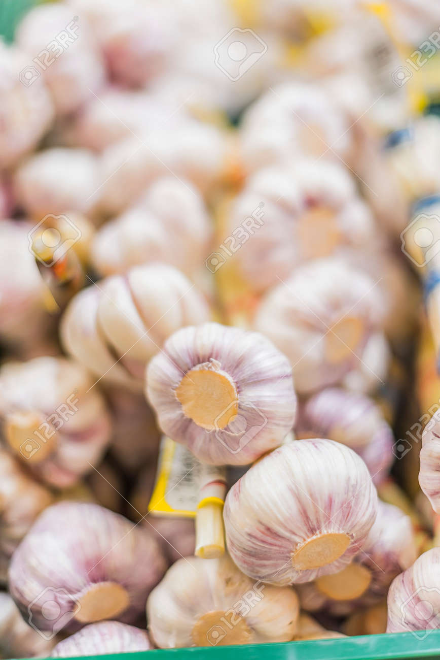 Garlic put up for sale in a grocery store - 168771562