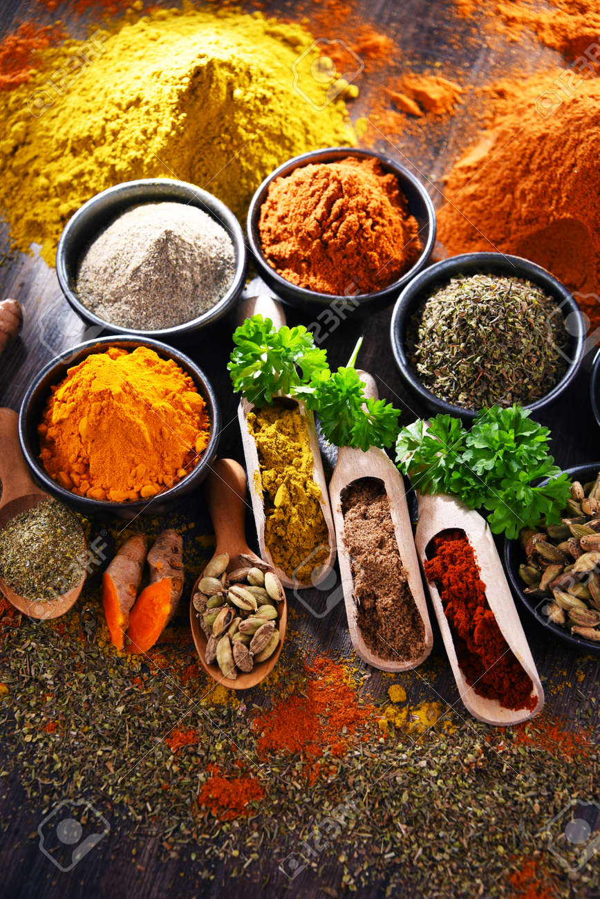 Variety of spices on wooden kitchen table. - 168771573
