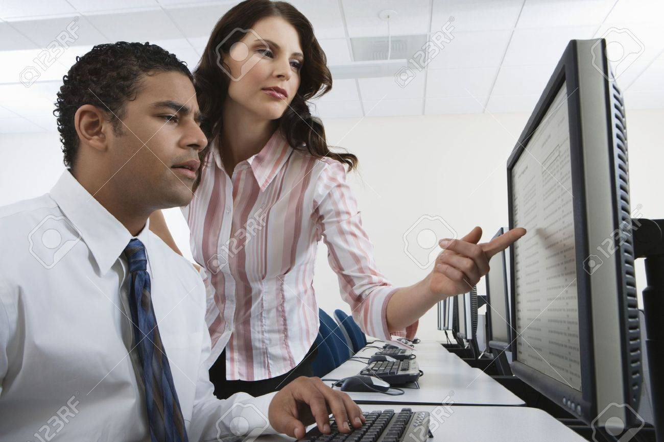 Man and woman using computer together Stock Photo - 3540497