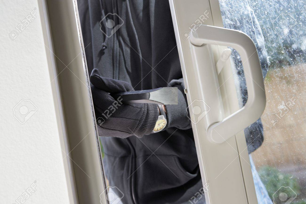 Burglar breaking into house, mid section Stock Photo - 3540778