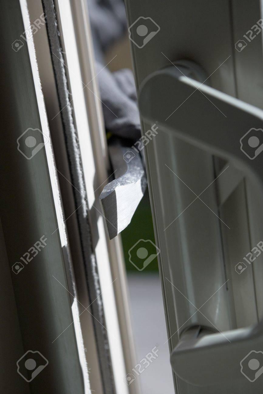 Burglar breaking into house, close-up of crowbar Stock Photo - 3540877