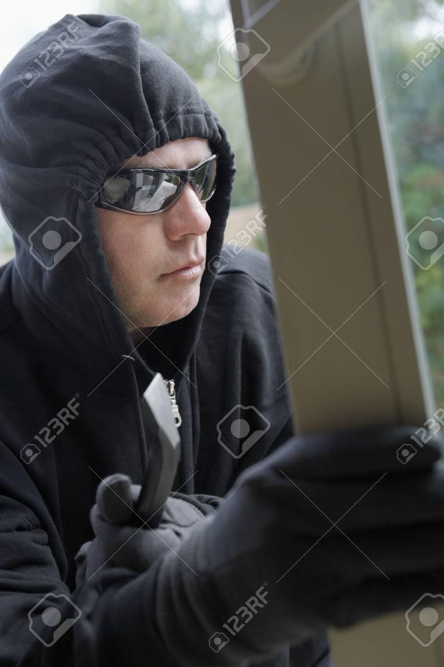 Burglar breaking into house Stock Photo - 3540897