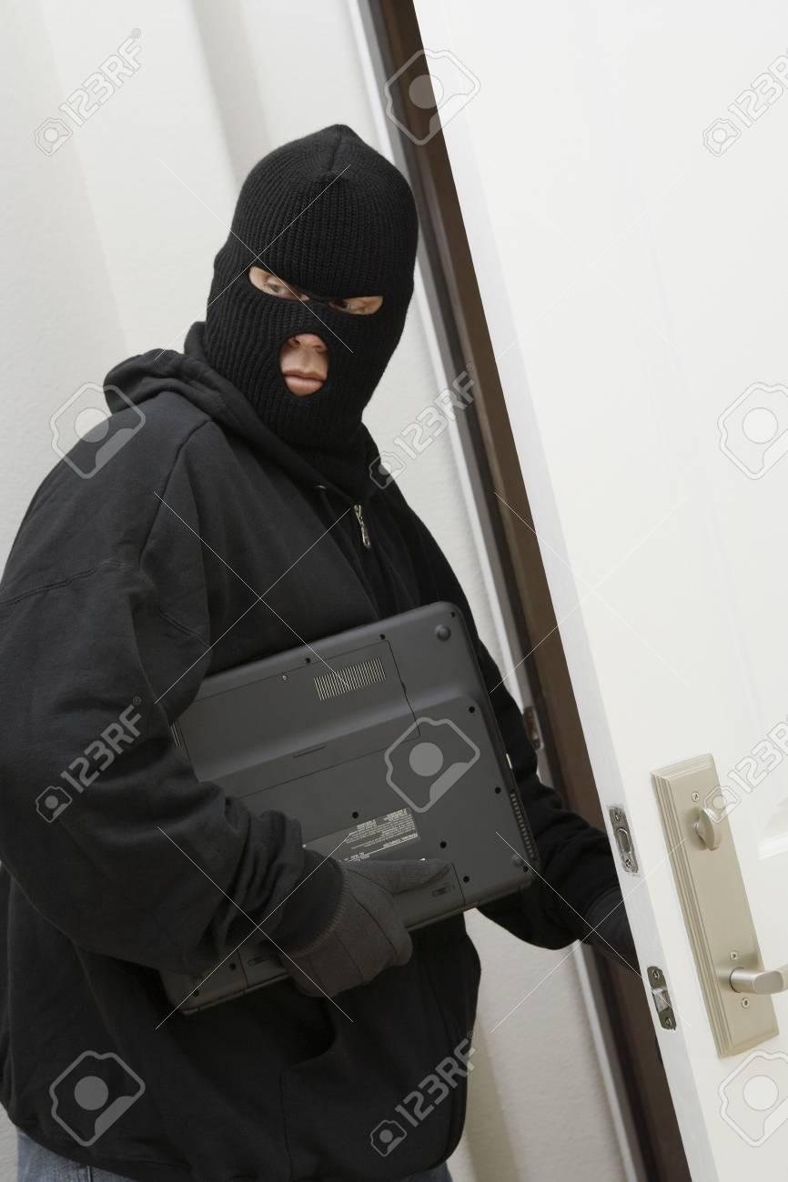 Burglar stealing laptop Stock Photo - 3540740