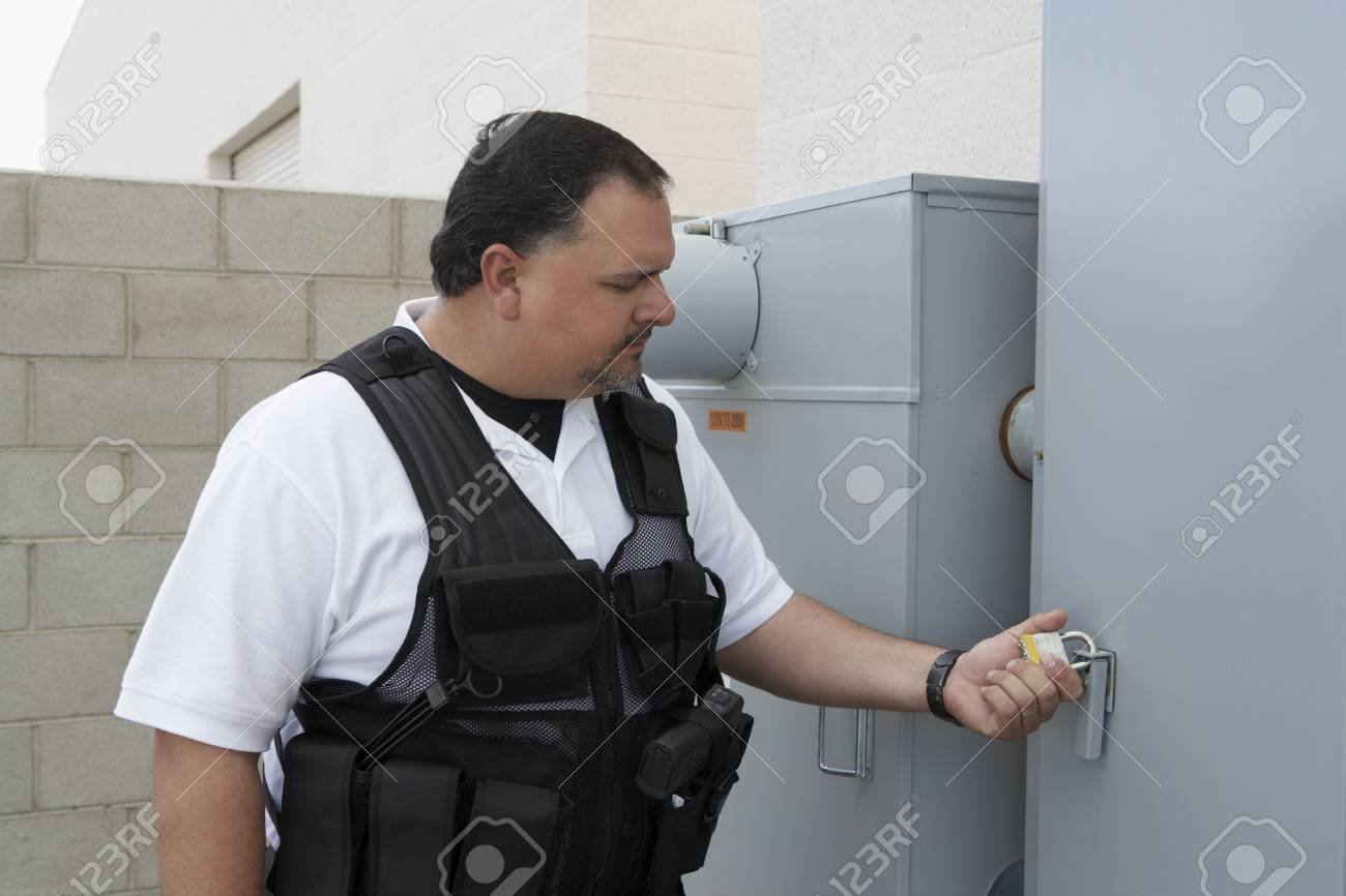 Security guard checking padlock Stock Photo - 3540727