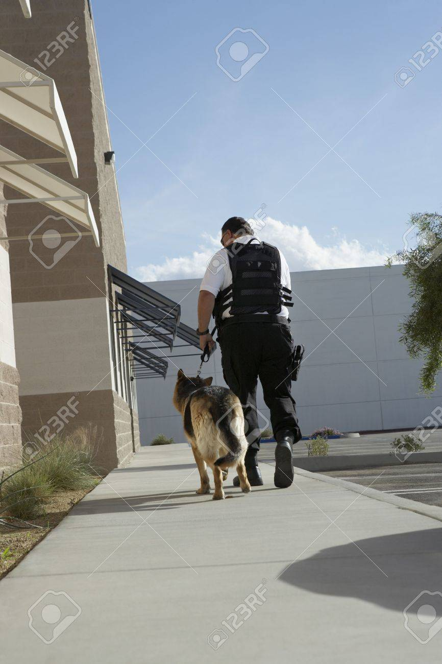Security guard with dog on patrol Stock Photo - 3540732