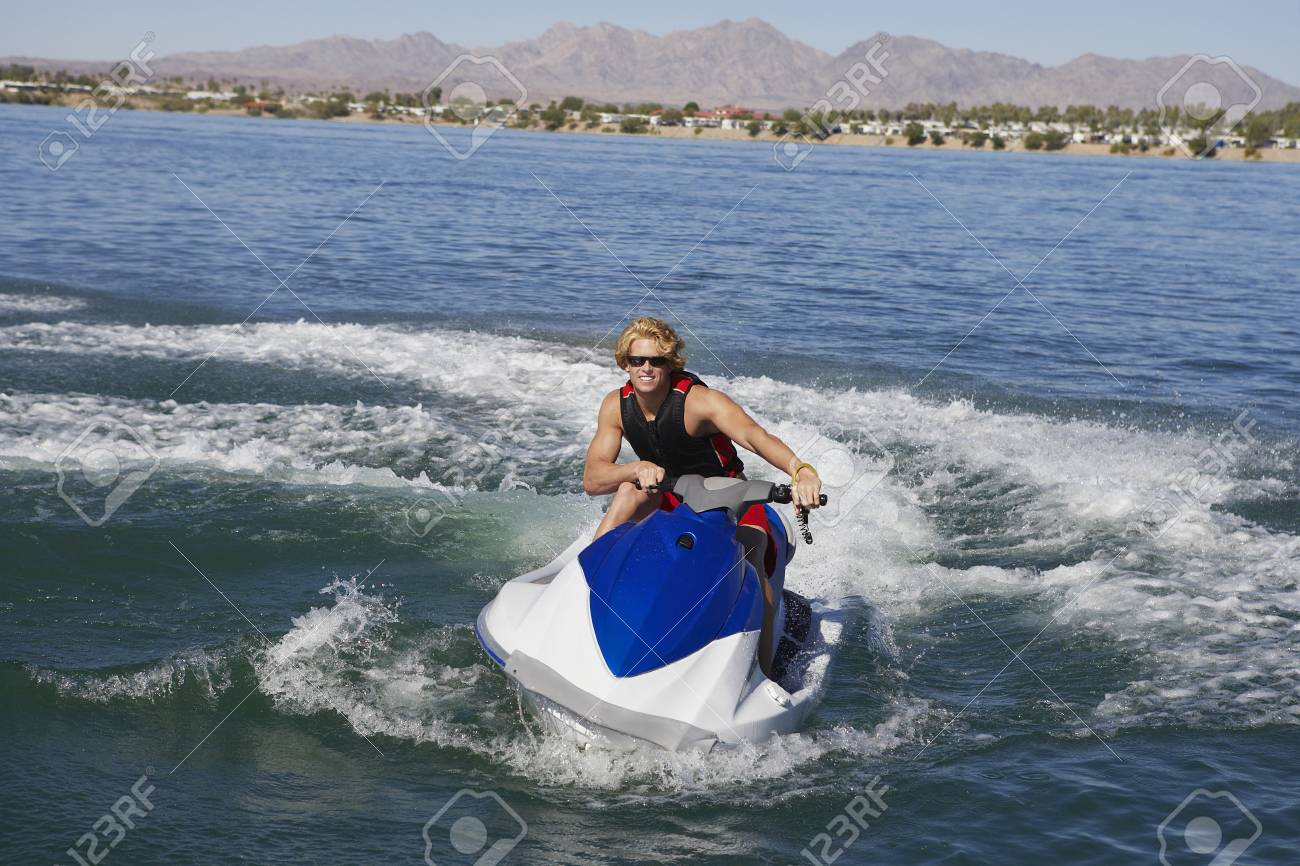 Young man riding jetski on lake Stock Photo - 3812645