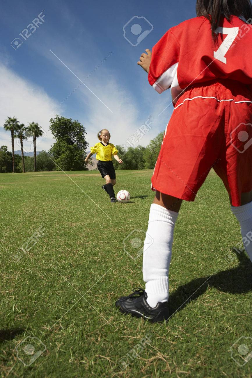 Two  girls (7-9 years) playing soccer Stock Photo - 3812636