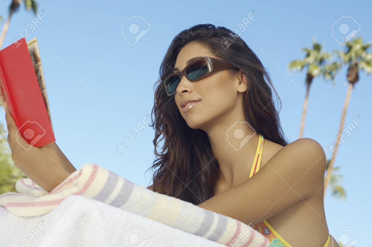 Woman reading book outdoors Stock Photo - 3811241