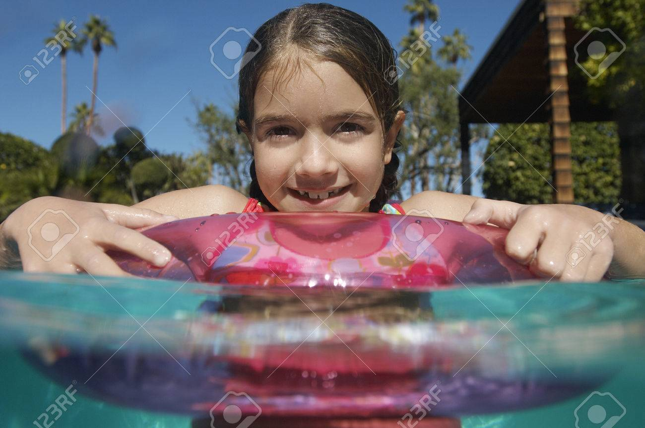 Girl with inflatable raft in swimming pool Stock Photo - 3812626