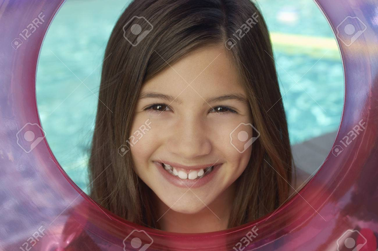 Girl looking through inflatable raft by water, portrait Stock Photo - 3812314