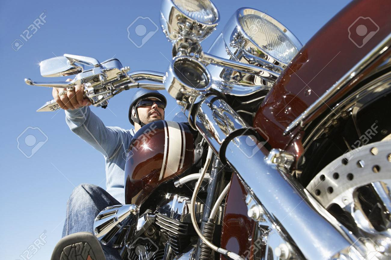 Biker riding motorcycle, low angle view Stock Photo - 3812399