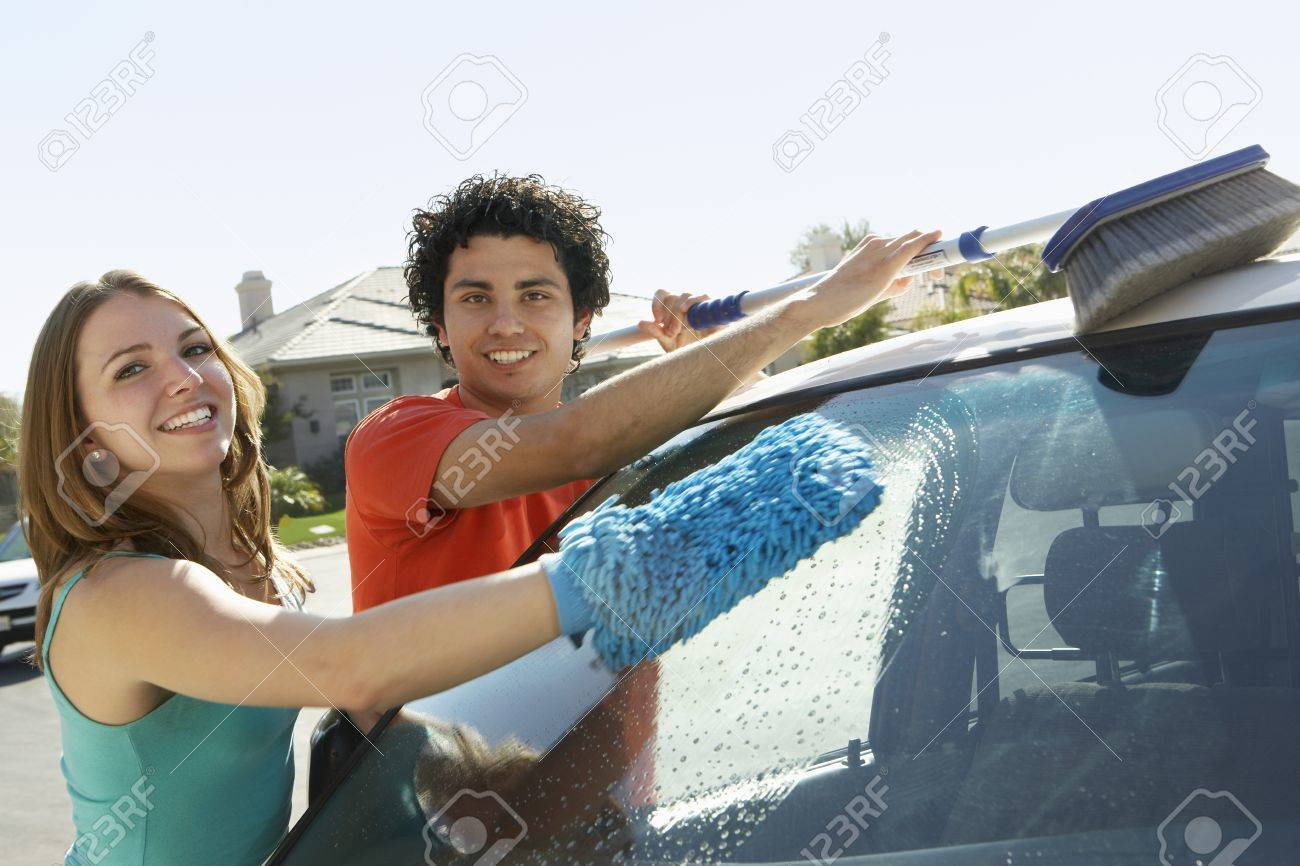 Young couple washing car Stock Photo - 3812167