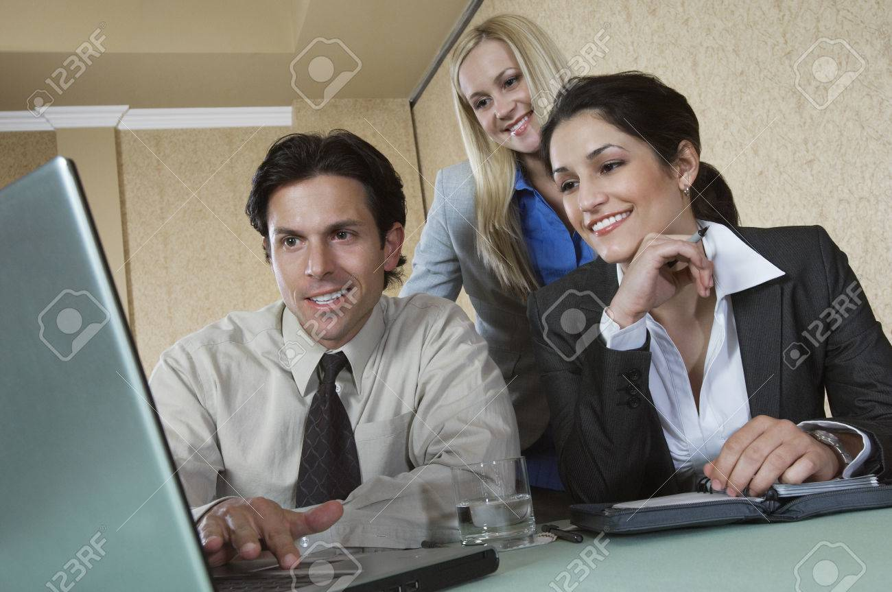 Business man and woman using laptop at conference meeting Stock Photo - 3813228