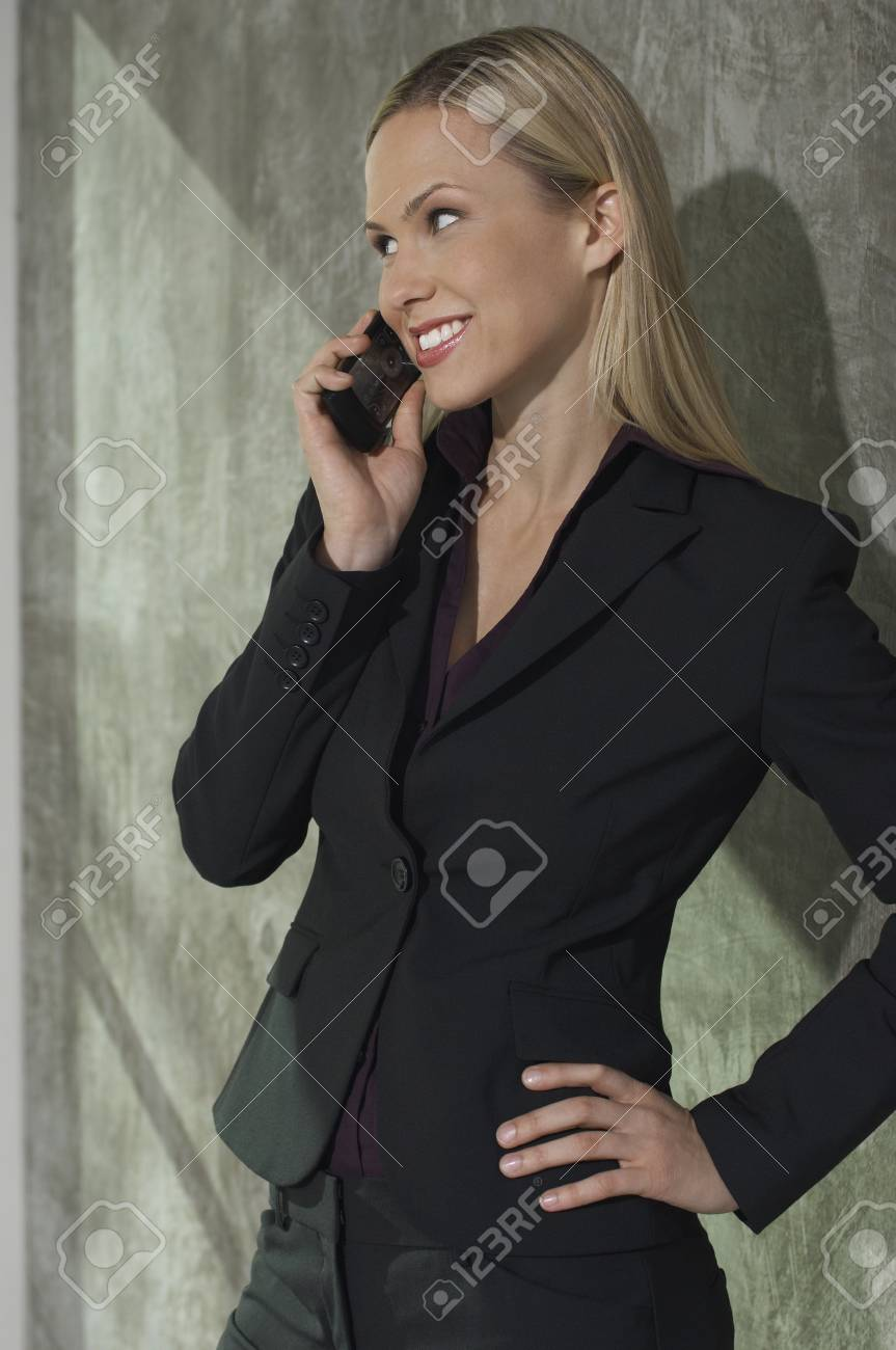 Businesswoman talking on mobile phone Stock Photo - 3813162