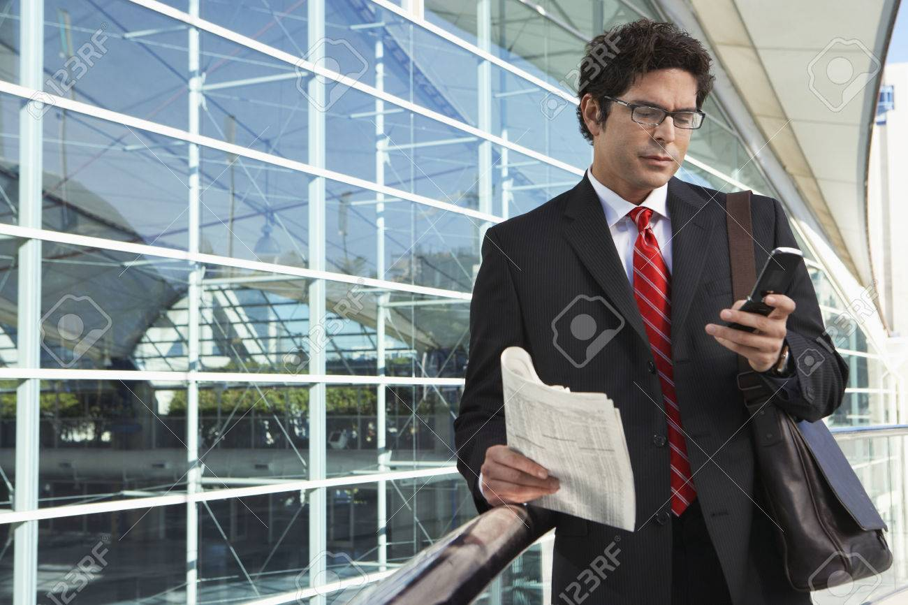 Businessman using mobile phone outside office building Stock Photo - 3811248