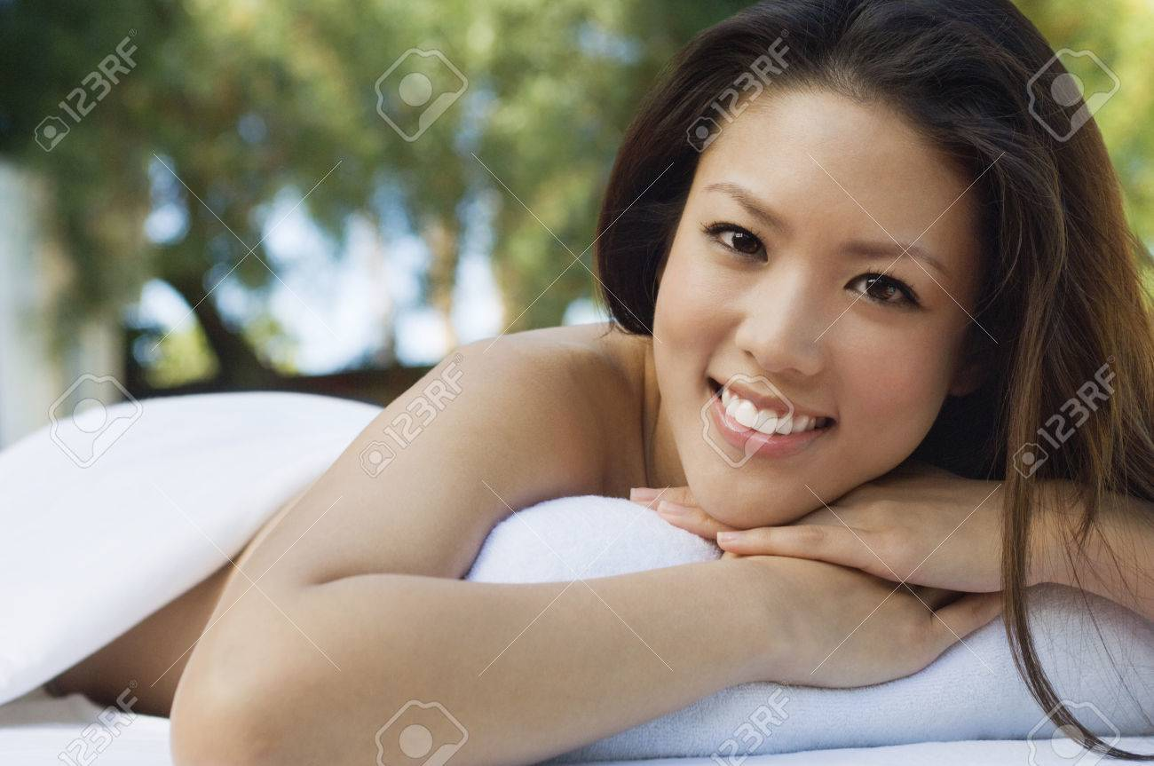 Young woman lying on massage table, outdoors, portrait Stock Photo - 3811479