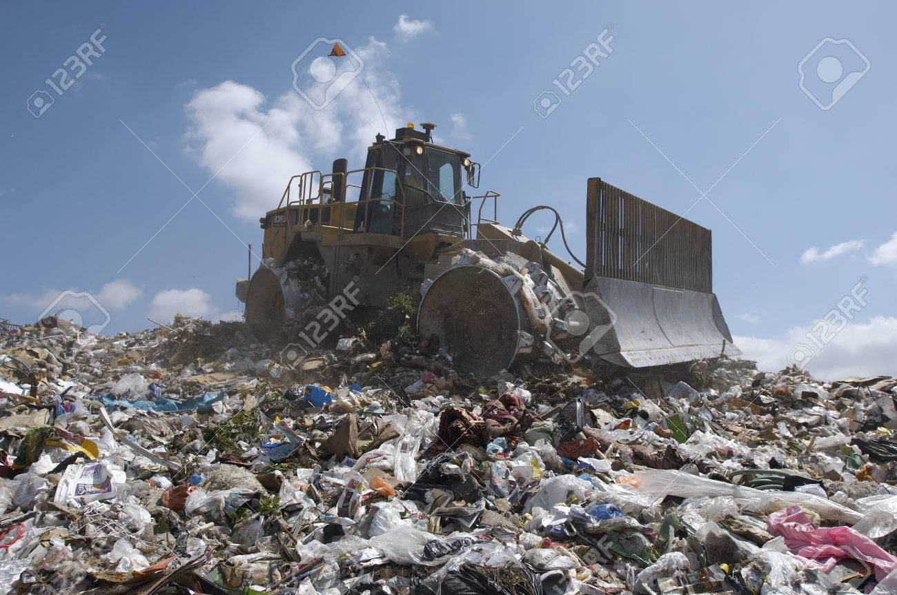 Digger working at landfill site Stock Photo - 3811550