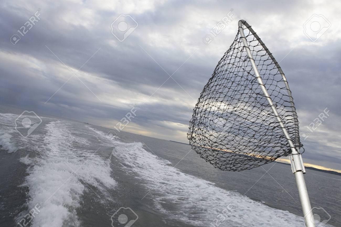 Fishing net sticking on back of speeding fishing boat Stock Photo - 3811497