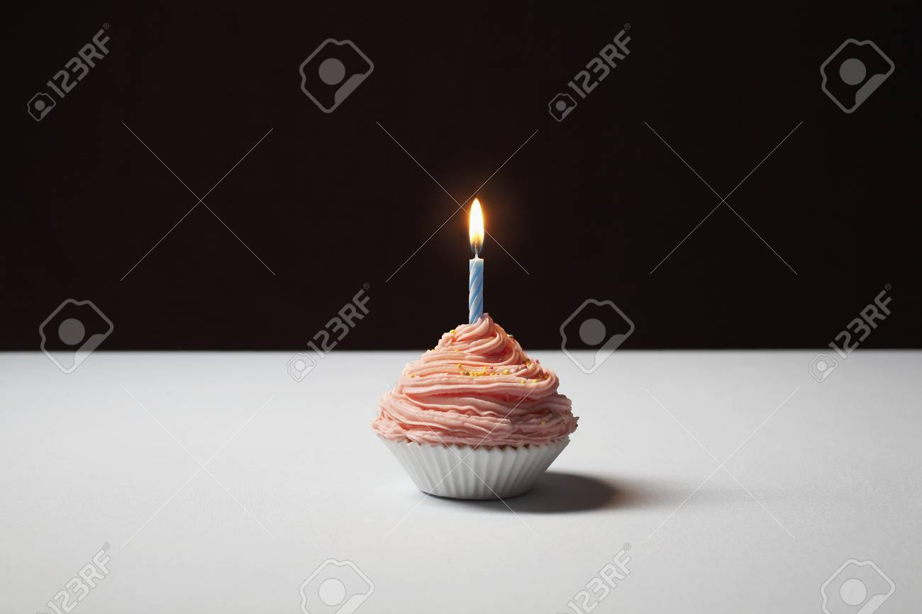 Single cupcake with birthday candle Stock Photo - 3811300