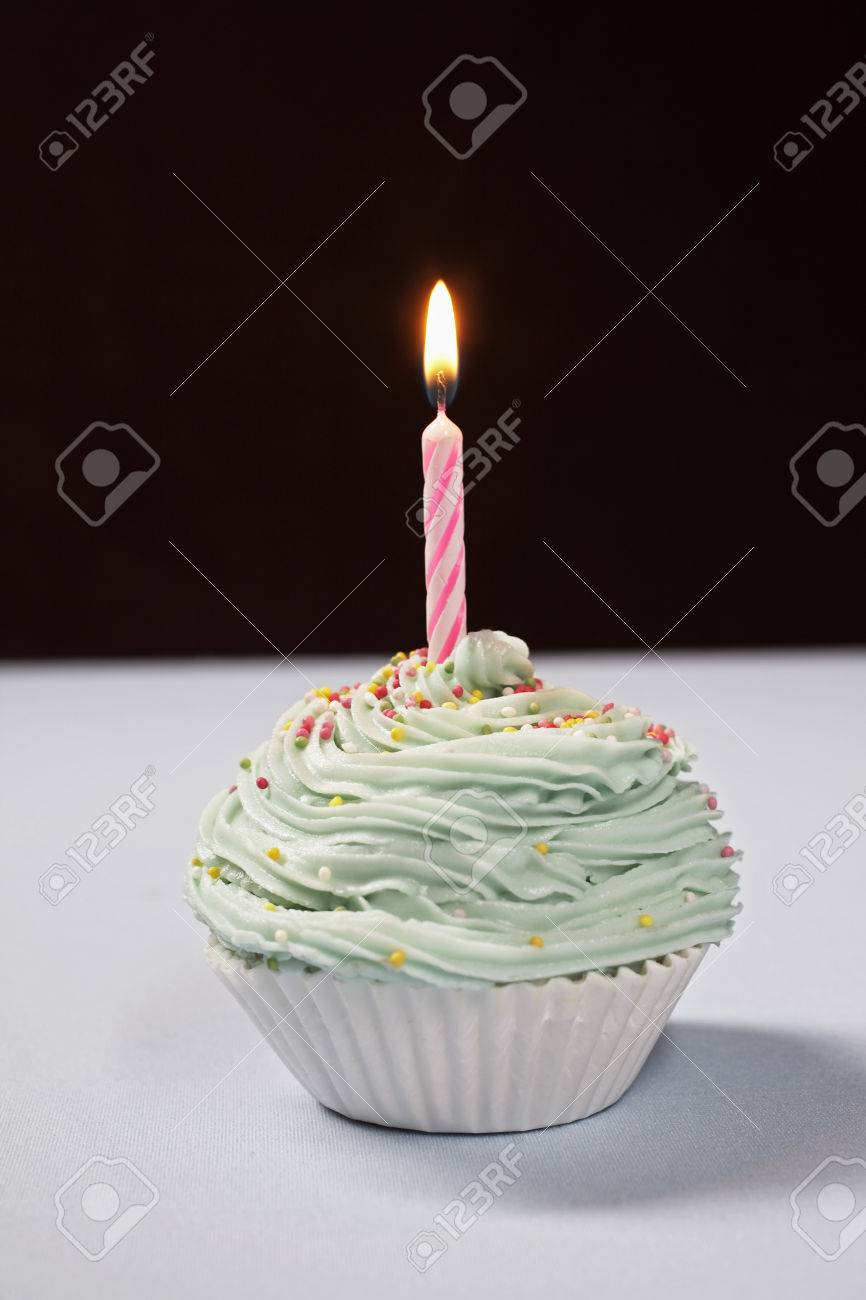 Single cupcake with birthday candle Stock Photo - 3811316