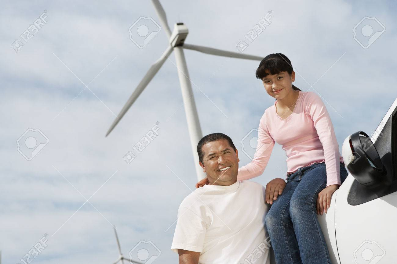 Father and daughter (7-9) at wind farm, portrait Stock Photo - 3811330