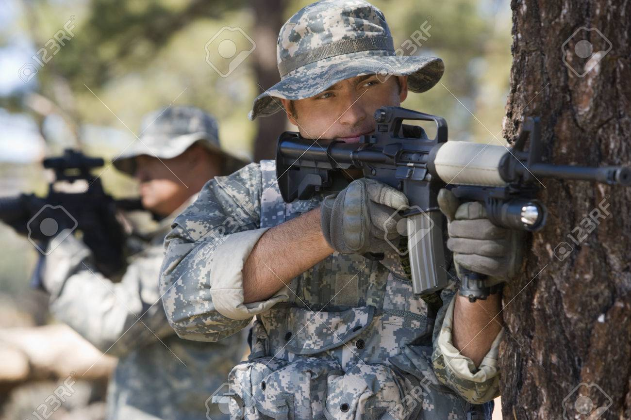 Soldiers aiming machine guns Stock Photo - 3811696