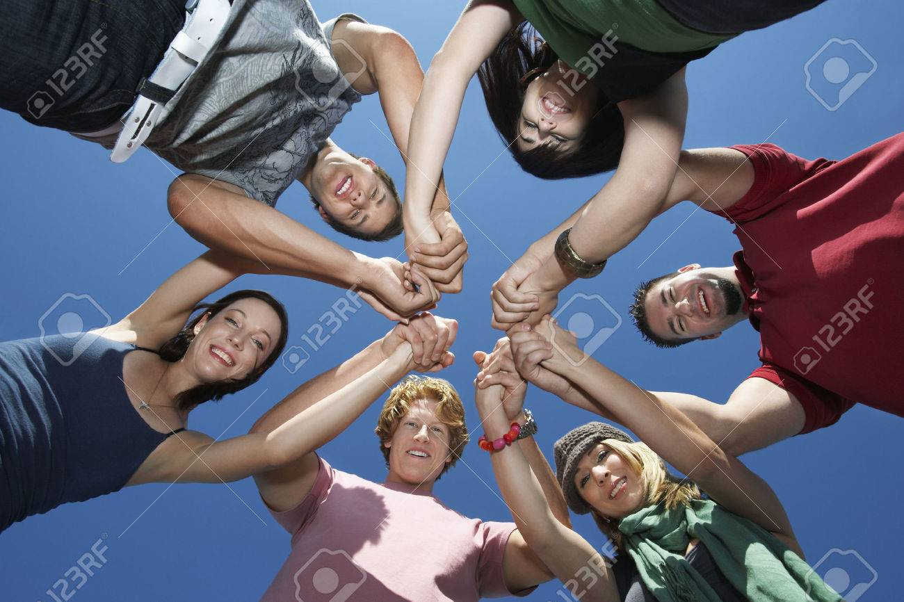Group of young people in circle, view from below Stock Photo - 3811996