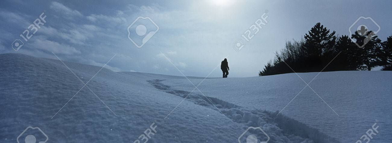 Person walking in snow Stock Photo - 3906425
