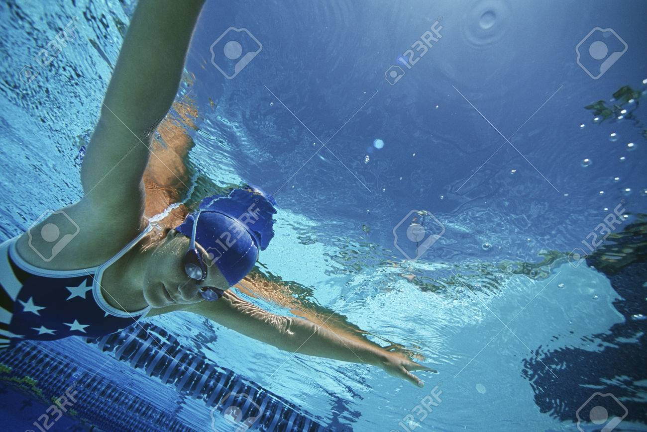 Female swimmer wearing United States swimsuit, swimming in pool Stock Photo - 3906427