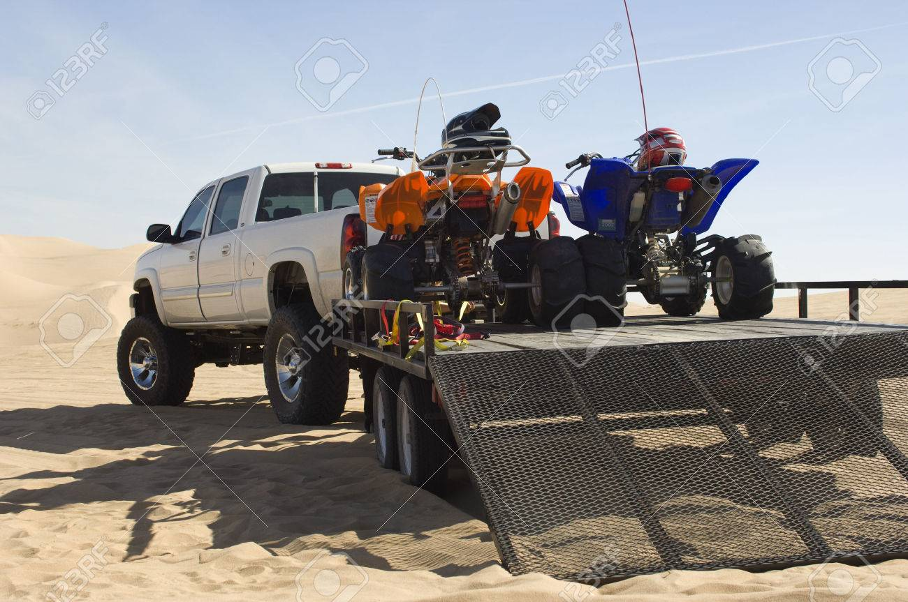 ATVs on Trailer Behind Pickup Truck Stock Photo - 4926133